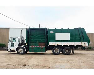 Volvo WX64 Garbage Truck