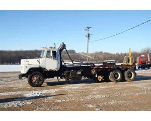 Mack DM690S Roll-Off Truck