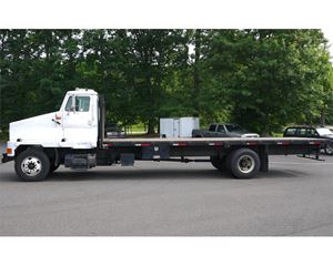 International 4900 Flatbed Truck