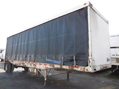 1986 Comet 32x102 Single Axle Combination Curtain Side Trailer - Spring, Fixed Axle