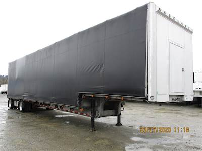 2000 Ravens STEP DECK WITH ROLLING TARP SYSTEM Drop Deck Trailer