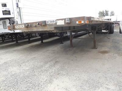1999 Transcraft 48ft Tandem Axle Steel Flatbed Trailer - Air Ride, Sliding Axle