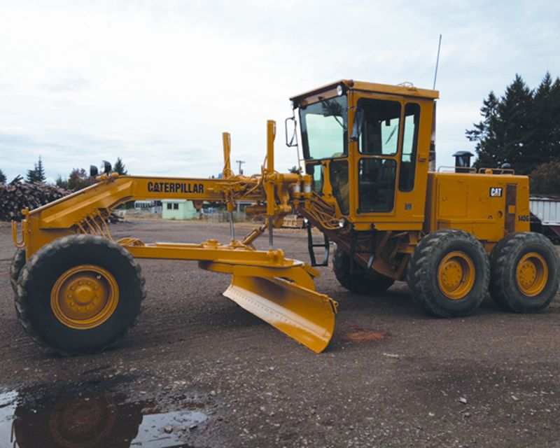 object moved On 140g caterpillar motor grader