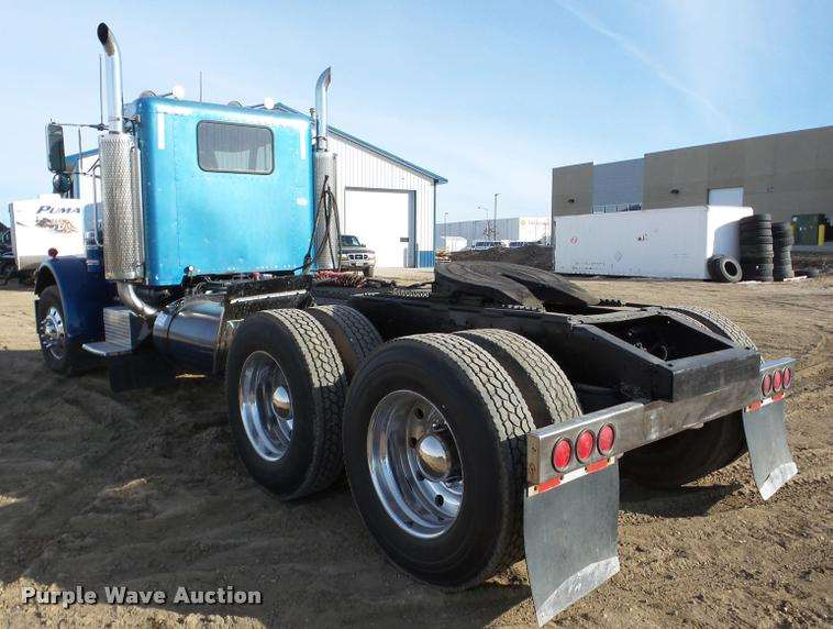 101877 furthermore 1997 Freightliner Fld Semi Truck 9044388 moreover 2006 KENWORTH W900 as well Rear Tandem Axle Pickup Trucks further 1996 International 9400 Semi Truck 9019241. on semi truck dual dump trailers for sale