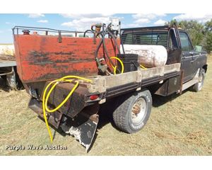 1983 Ford F350 flatbed pickup truck