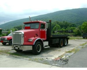 Freightliner FLD12064SD Roll-Off Truck