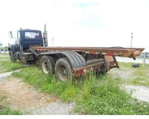 Mack RD690S Roll-Off Truck