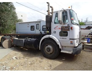 White/ GMC WX64T Roll-Off Truck