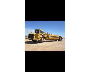 Caterpillar 621G/Mega 8000 Gallon Water Wagon