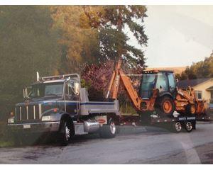 1999 Peterbilt 330 Dump Truck, 16 Ton Zieman Trailer, & 2012 CASE 580SN Backhoe Bundle