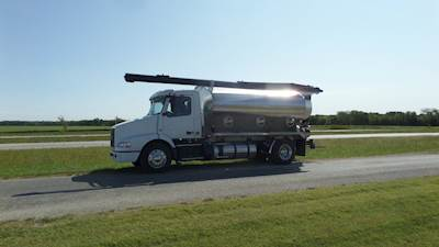 2012 Volvo VNL300 with a 13.5 KT Pacer Aluminum Feed Body, D13 375 hp engine, 10 speed